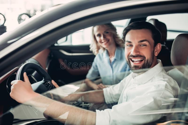 Couple sitting in new car royalty free stock image