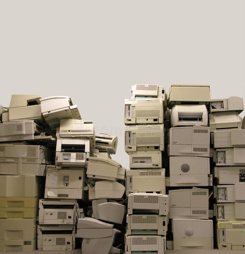 E-waste. Stack of old and obsolete printers ready for recycling or disposal royalty free stock photography