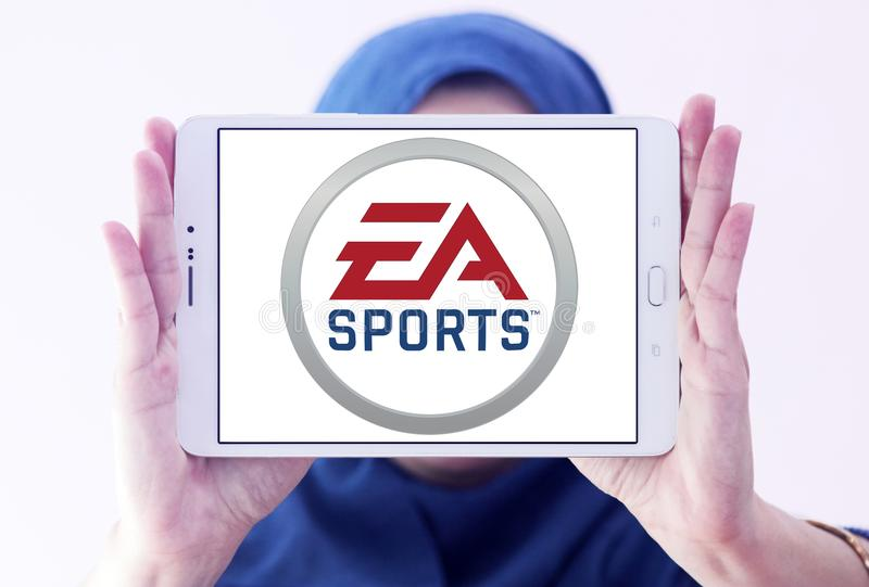 EA Sports logo. Logo of EA Sports on samsung tablet holded by arab muslim woman. EA Sports is a division of Electronic Arts that develops and publishes sports stock photo