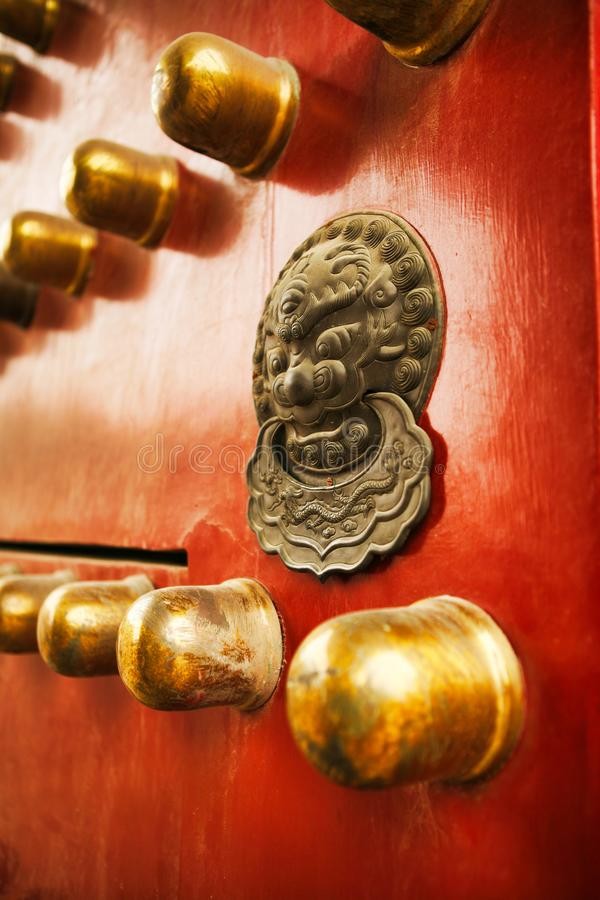Richly decorated red wooden door with decoration in the Forbidden City, Beijing, China. stock photo