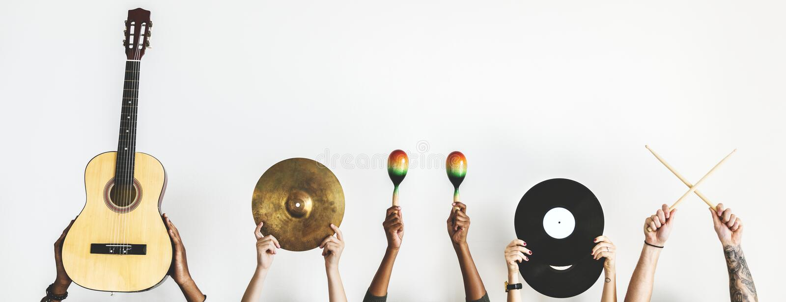 Each hands are holding music instruments stock photos