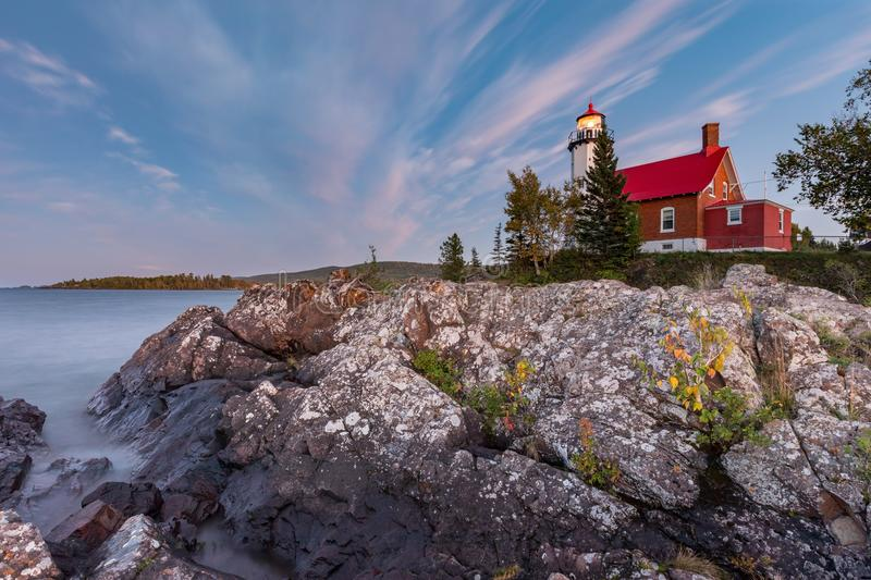Eagle Harbor Light at Dusk. Eagle Harbor Light stands above a rocky entrance to Eagle Harbor in the Keweenaw Peninusla of Michigan royalty free stock image