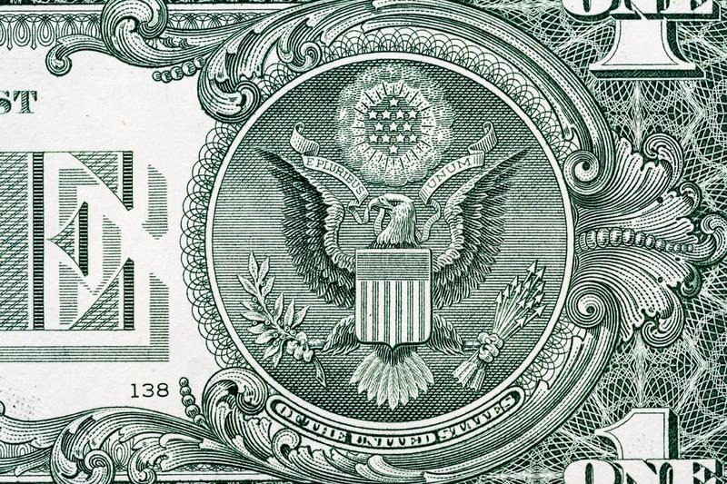 Eagle macro close-up on a US 1 dollar banknote. Detail of one dollar bill. stock image