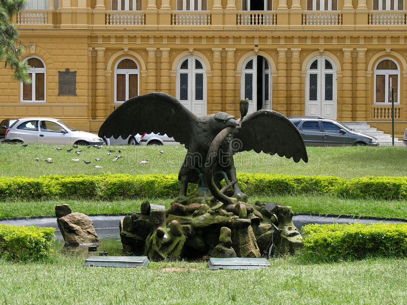 Eagle and snake statue stock photo