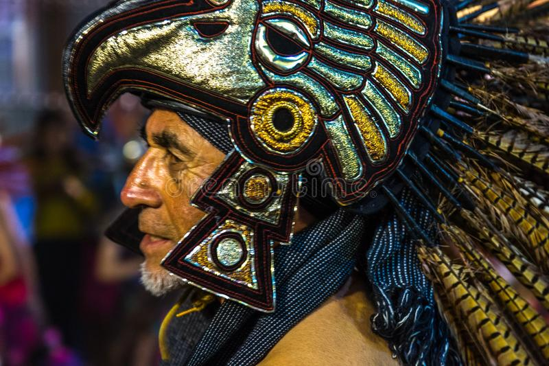 Eagle Warrior Headdress. A man in traditional costume marches in a parade in Oaxaca, Mexico royalty free stock photo
