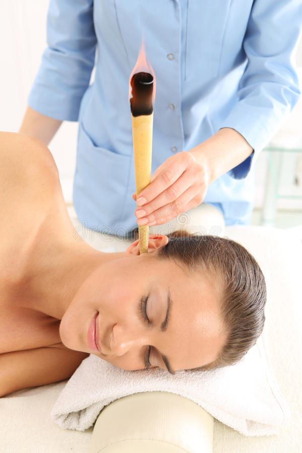 Ear candling, natural purifying treatment stock images