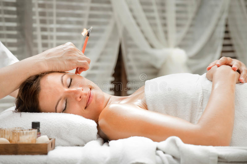 Ear Candling in Spa stock image