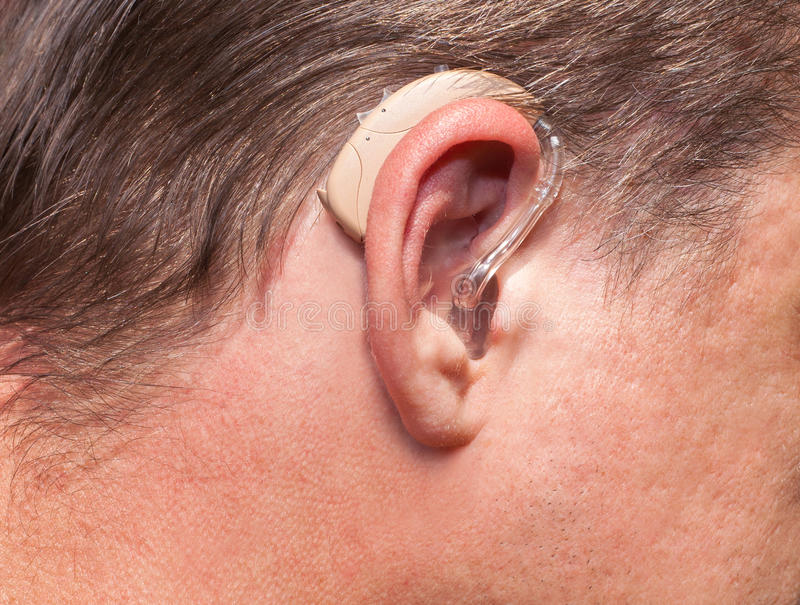 Ear close up with hearing aid royalty free stock images