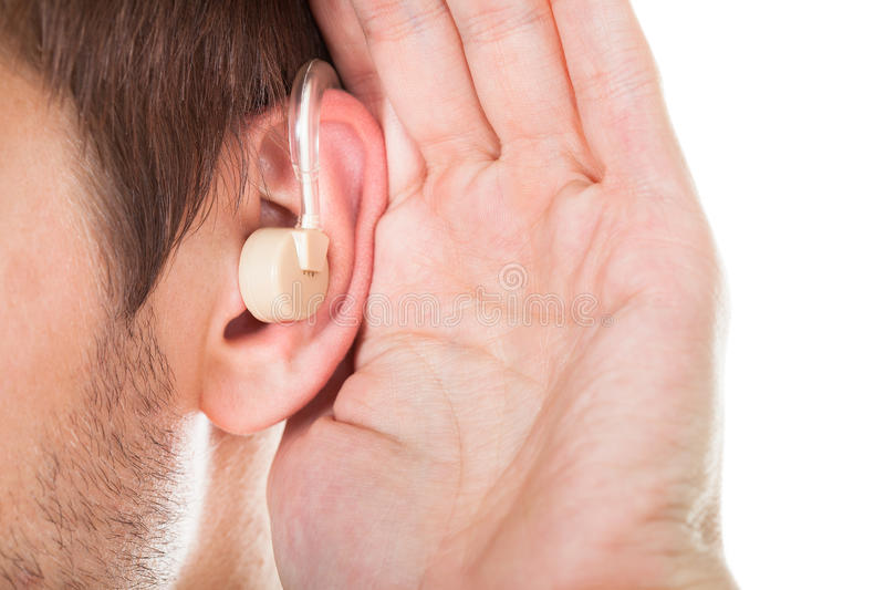 Ear with hearing aid royalty free stock images