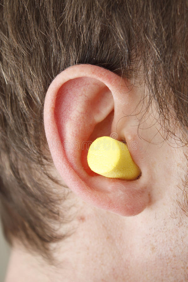 Ear plug. In a male ear royalty free stock photos