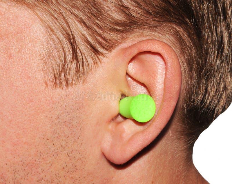 Ear plug. Closeup of ear plug in human ear stock photo