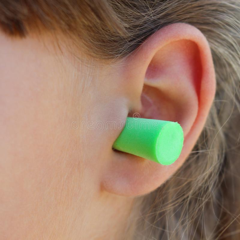 Ear plugs to protect against noise. Ear plugs to protect against the noise royalty free stock photo