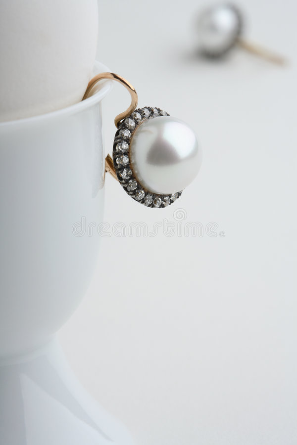 Ear-ring. Still-life with diamond ear-ring and egg stock photography