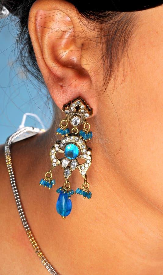 Ear ring. Diamond ear ring looking great on model's ear stock image