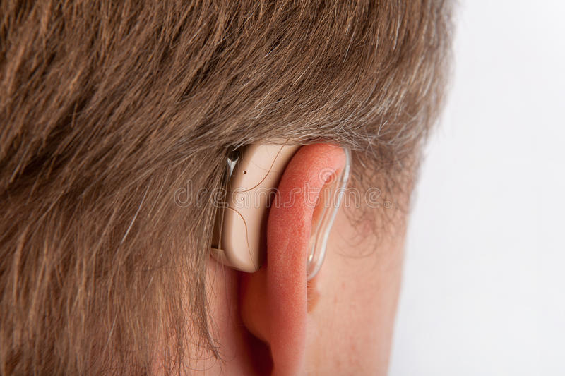 Ear of a senior man close-up with hearing aid royalty free stock photo