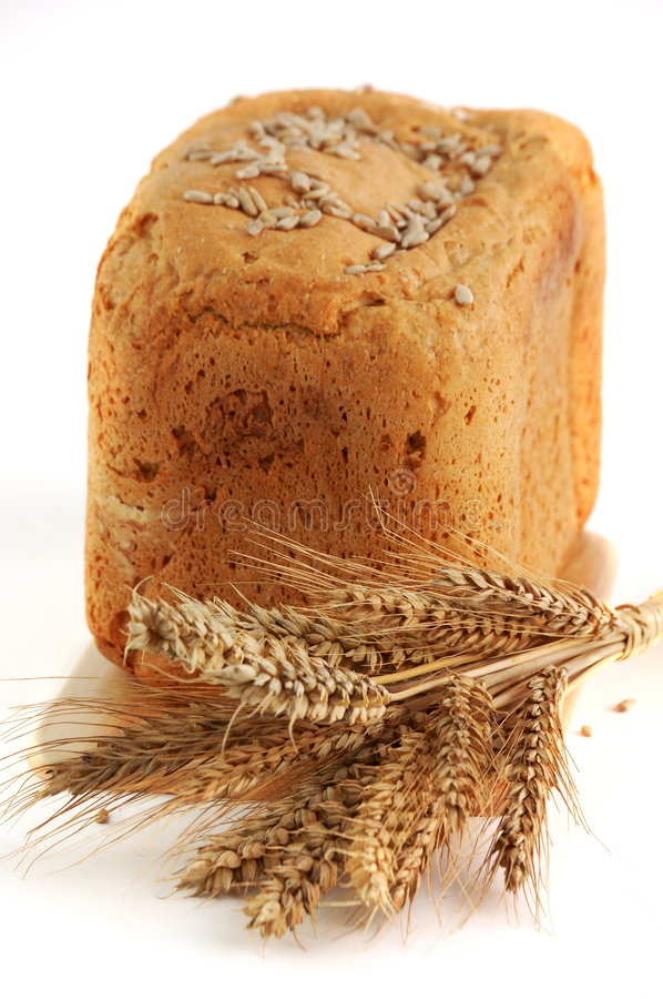 Ear of wheat with homemade bread royalty free stock photo