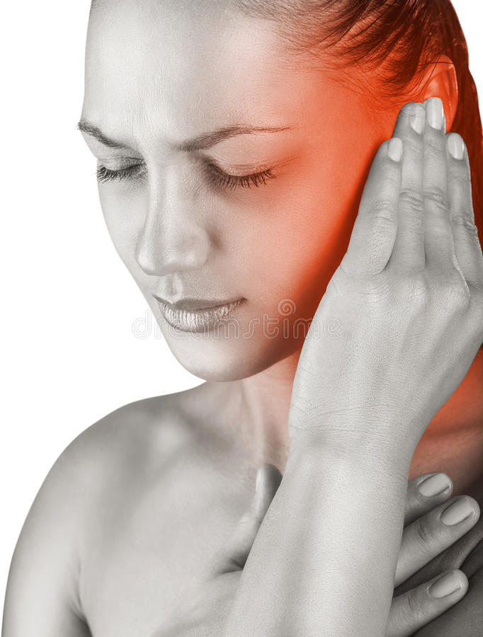 Earache. Young woman with ear pain, holding hand on his head. Isolate on white background stock photo