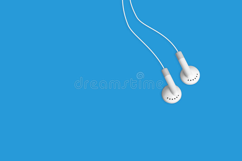 Earbuds headphones listen to mp3 music royalty free stock images