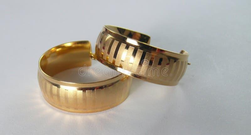 Earings-Gold stockbilder