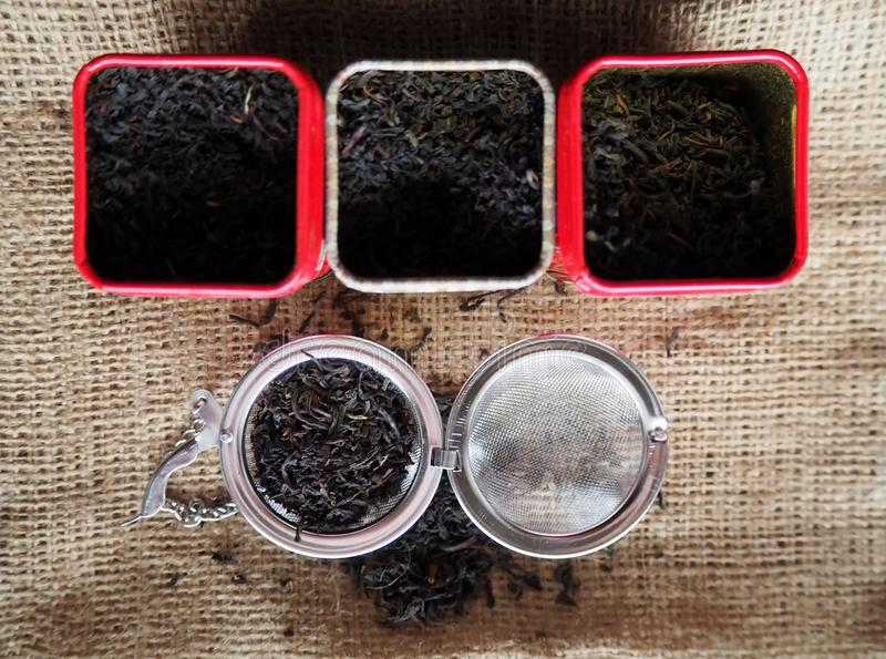 Earl grey blend tea with its ingredients of black tea and bergamot flavour in tin boxes on jute canvas stock image
