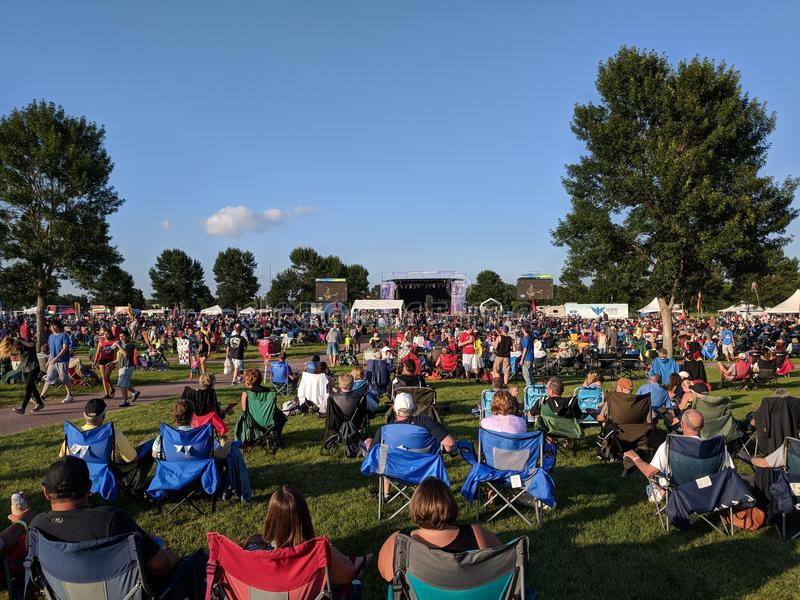 Early Afternoon at the Free JazzFest Concert. The crowd is already pouring into the free Sioux Falls JazzFest concert, 2018 stock photography