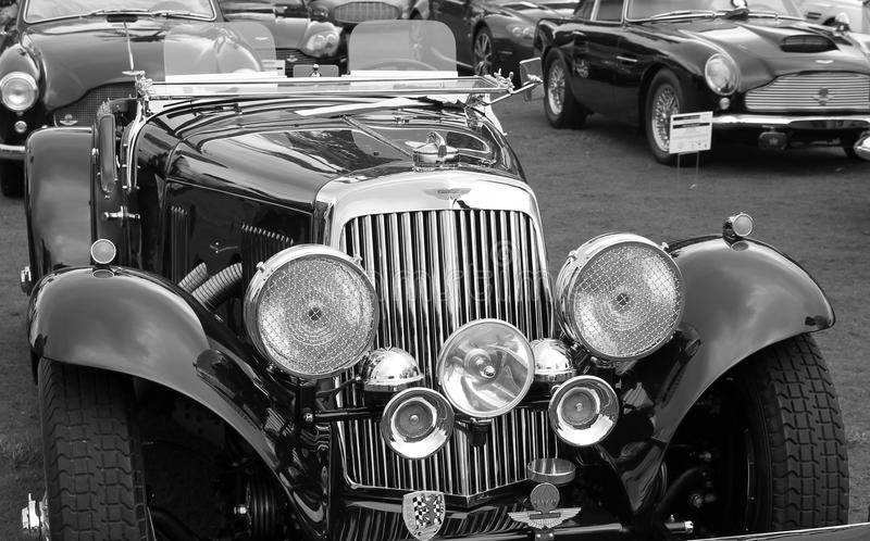 Early aston martin roadster. Antique 1938 Aston Martin 15/98 Roadster at outdoors event in south Florida event among other Aston Martin cars. black and white royalty free stock image