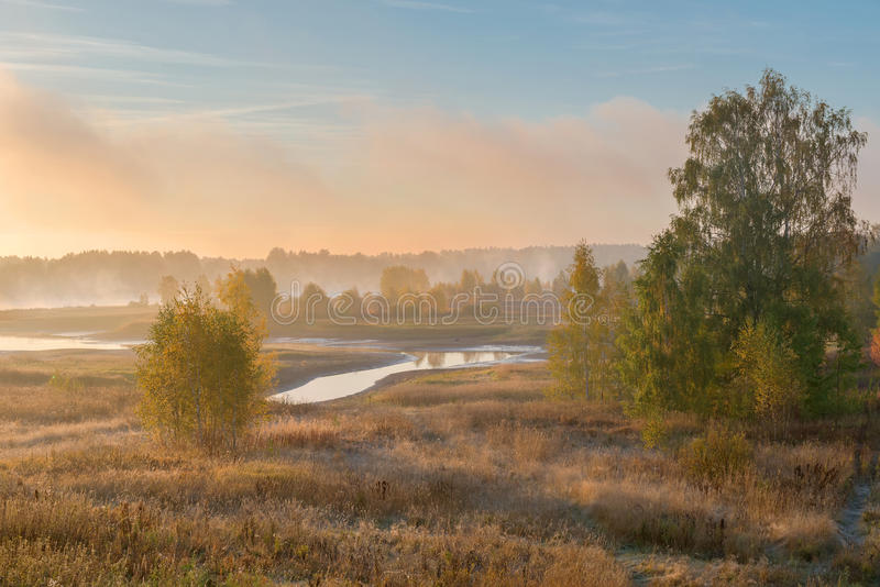 Early autumn morning. The sunrise, the fog over the river stock photos