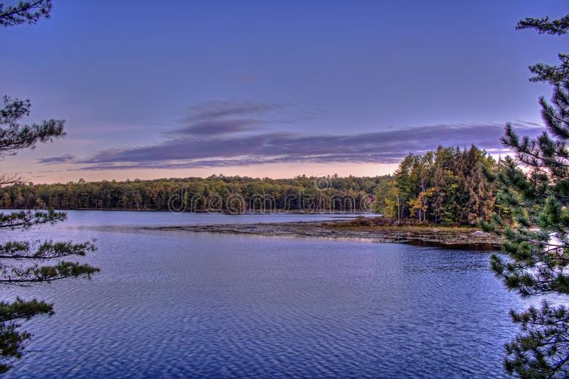 Early Autumn Scene On A Canadian Lake royalty free stock photo