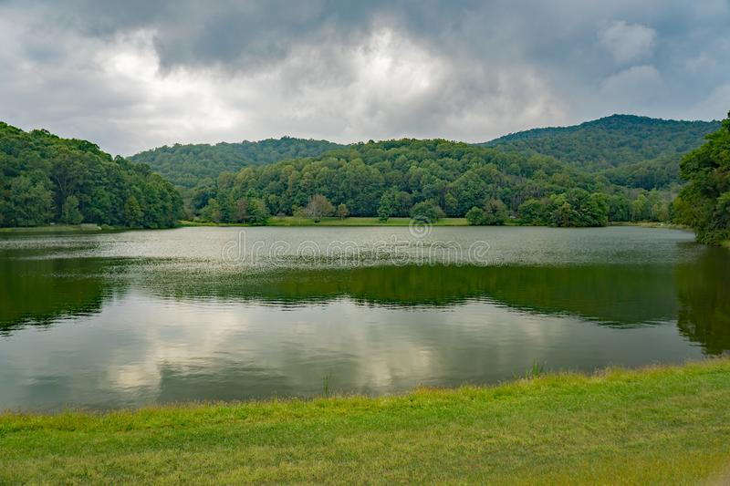 Early Autumn View of Abbott Lake. An early autumn view of Abbott Lake located at the Peaks of Otter, Blue Ridge Parkway, Bedford County, Virginia, USA stock photo