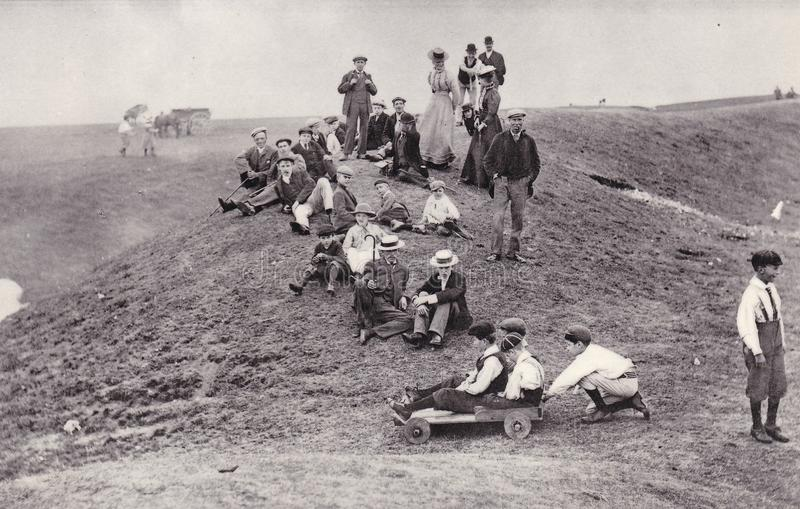 Photo postcard of Bank Holiday, Uffington Castle, Oxfordshire, 1899. Early black and white picture postcard of people taking a break for Bank Holiday at stock photo