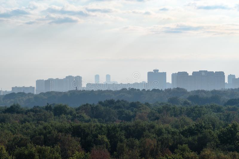 Early blue dawning over urban park and city. Early blue dawning over urban park and apartment houses in Moscow city in September stock photography