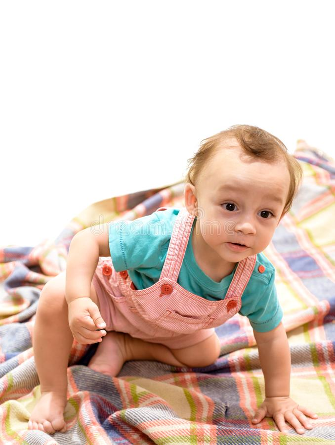 Early childhood development. Adorable small baby. Little boy child. Cute baby sit on floor. Innocent small kid. Happy. Early childhood development. Adorable stock image