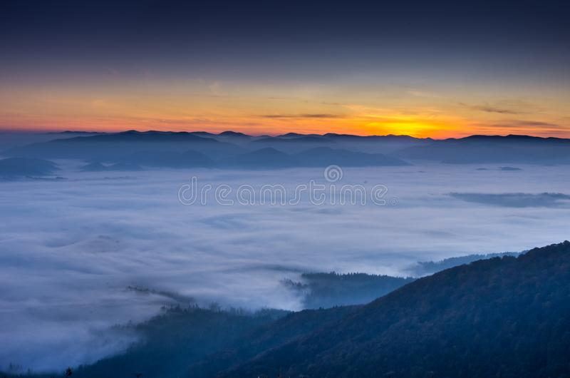 Early dawn. The rising of the sun above the clouds. Expectation of the sun. royalty free stock images