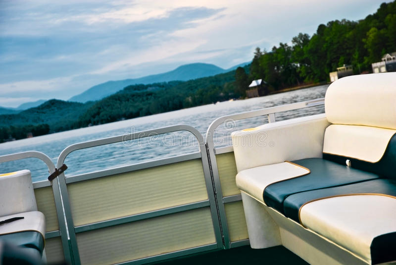 Early Evening Boat Ride. View from a pontoon boat during an evening boat ride on a mountain lake royalty free stock images