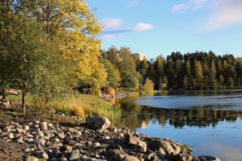 Early Fall Season Landscape from Lake Valkeinen, Kuopio, Finland. Stunning landscape photo from lake Valkeinen, Kuopio, Finland. Colorful trees, clear sky and royalty free stock photography