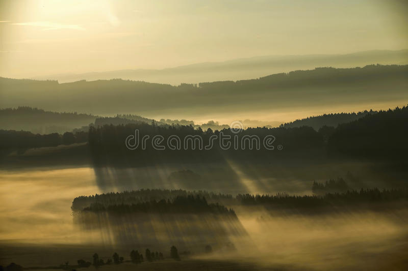 Early fogy autumn morning on the Czech Austrian border. Misty woods and field, Europe landscape stock image