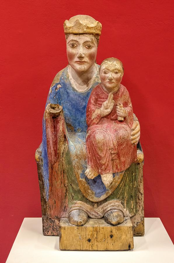 Wooden sculpture of Virgin Mary with Jesus Christ stock photography