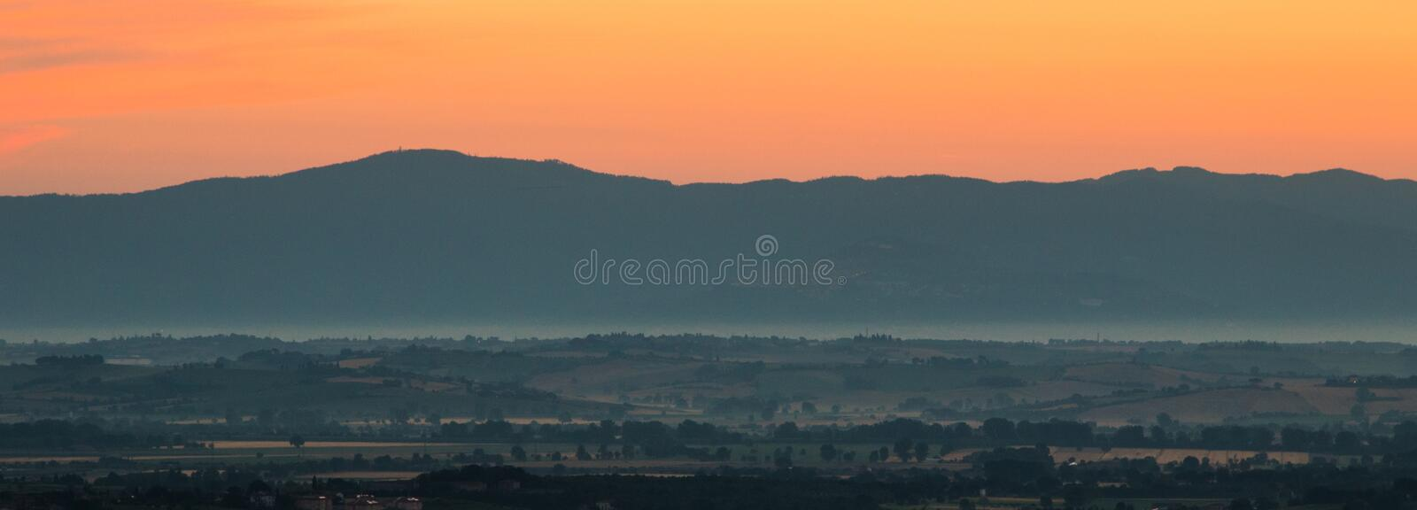 Tuscan Dawn. The early light begins to glow brighter on the valley below in Tuscany stock photo