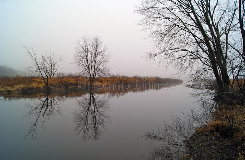 Misty Early Morning Reflections at the River stock photography