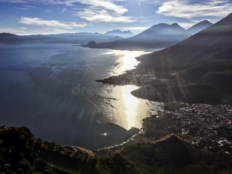Early monring light on Lake Atitlan & 5 volcanoes, Guatemala. View from Indian Nose over Lake Atitlan, 5 volcanoes, San Juan La Laguna & San Pedro la Laguna in royalty free stock photos
