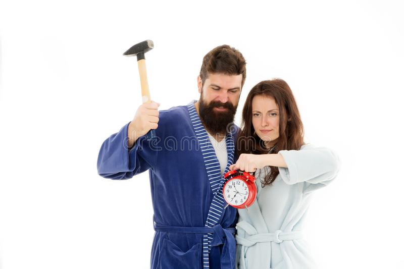 Early morning anxiety. Lets get rid of this annoying alarm clock. Couple in bathrobes going to destroy alarm clock and. Stay at home. Breaking rules. Man with royalty free stock photos