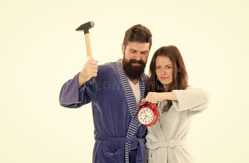 Early morning anxiety. Lets get rid of this annoying alarm clock. Couple in bathrobes going to destroy alarm clock and. Stay at home. Breaking rules. Man with royalty free stock image