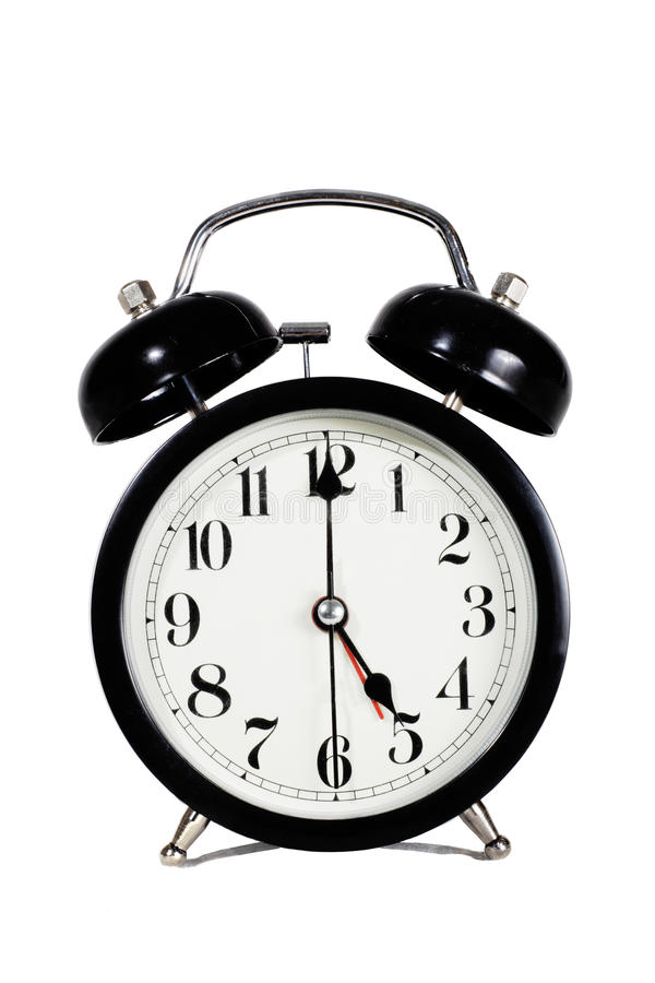 Early morning, clock. A black retro clock showing early hours of the day representing the concept of busy life stock images