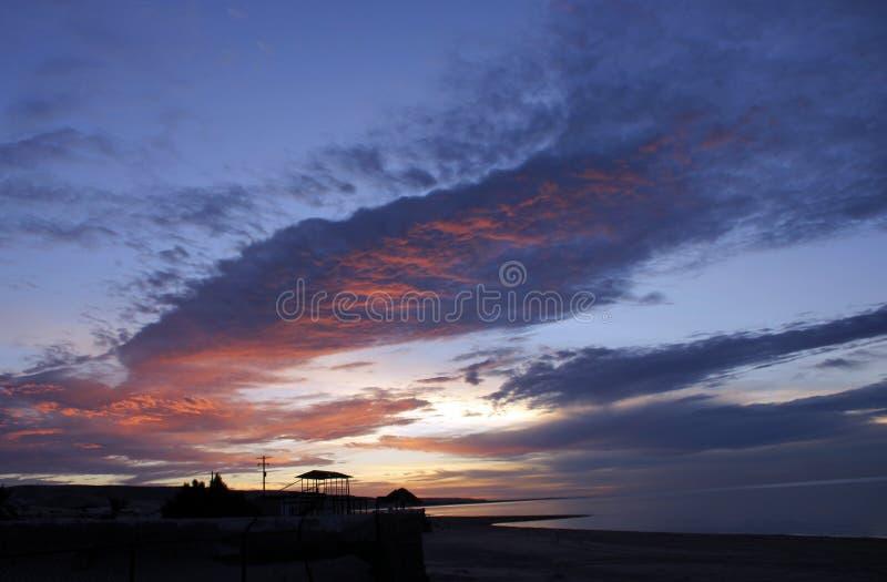 Sunrise, shores of Sea of Cortez, El Golfo de Santa Clara, Mexico. Early morning clouds gather over the Sea of Cortez near El Golfo de Santa Clara, Mexico. Tiki royalty free stock image