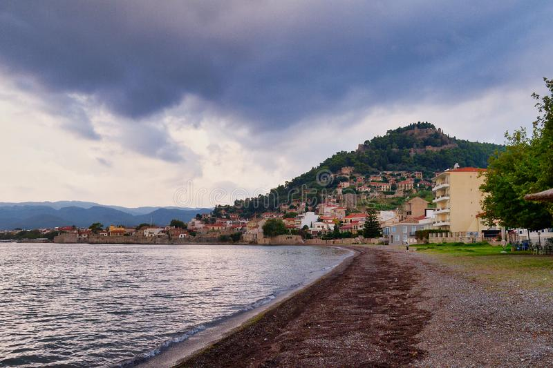 Early Morning Dark Clouds, Nafpaktos, Greece. Gloomy conditions with dark dense early morning clouds over Nafpaktos, Greece, with Gulf of Corinth sea water and royalty free stock images