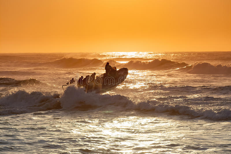 In the early morning a dive boat transports recreational divers from Umkomaas beach to the Aliwal Shoal off the KZN South Coast. stock photography