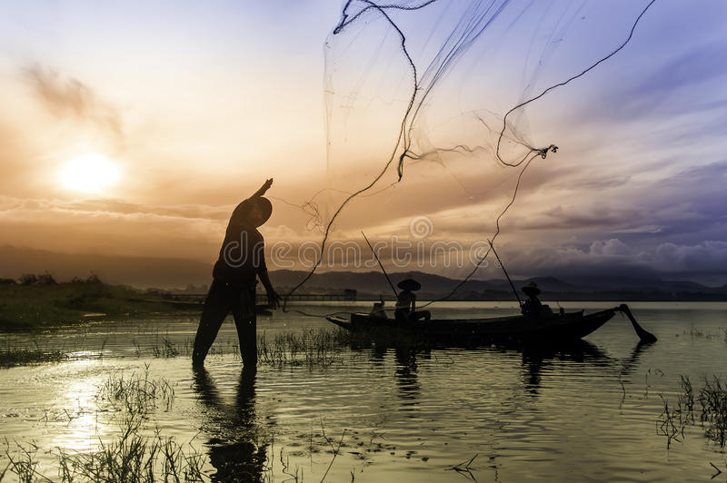 Early morning fishing boat stock images