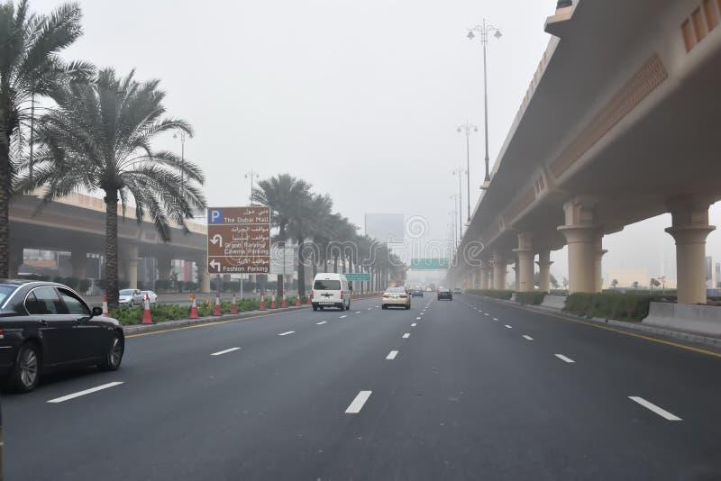Early morning fog on the road, Dubai, United Arab Emirates stock photo