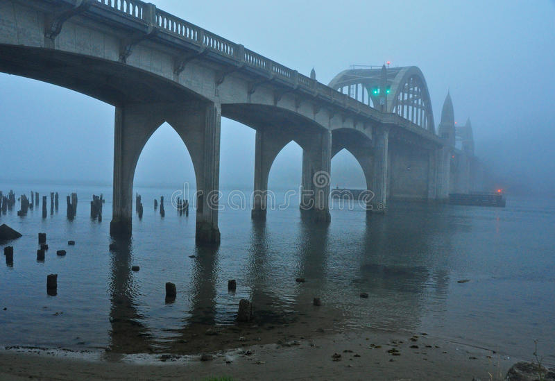 Early Morning Fog Shrouds the Siuslaw River Bridge royalty free stock image
