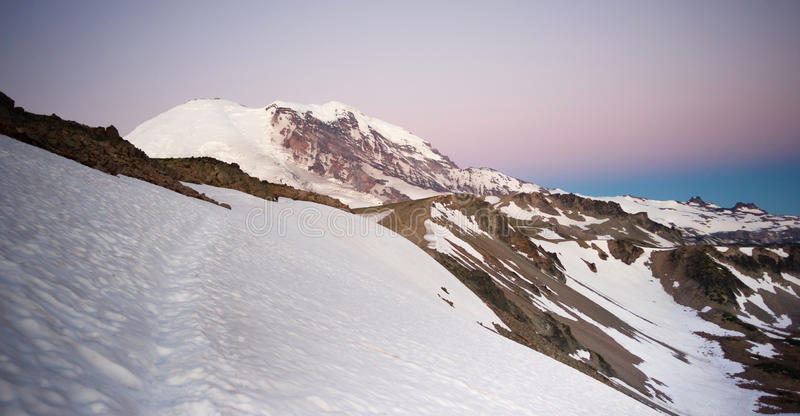 Early Morning Hike Burroughs Mountain Mt Rainier National Park. A fairly treacherous ice field with a pitch capable of taking life hiking Burroughs Mountain stock images
